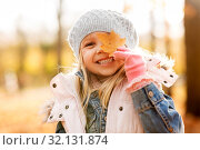 Купить «happy little girl with maple leaf at autumn park», фото № 32131874, снято 21 октября 2018 г. (c) Syda Productions / Фотобанк Лори