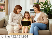 Купить «mother, daughter and grandmother with tablet pc», фото № 32131954, снято 25 мая 2019 г. (c) Syda Productions / Фотобанк Лори