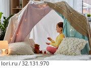 Купить «girl playing tea party with teddy in kids tent», фото № 32131970, снято 18 февраля 2018 г. (c) Syda Productions / Фотобанк Лори