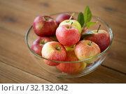 Купить «ripe apples in glass bowl on wooden table», фото № 32132042, снято 24 августа 2018 г. (c) Syda Productions / Фотобанк Лори