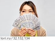 Купить «asian woman with hundreds of dollar money», фото № 32132134, снято 11 мая 2019 г. (c) Syda Productions / Фотобанк Лори
