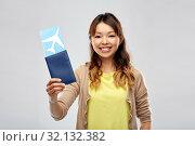 Купить «african woman with passport and air ticket», фото № 32132382, снято 11 мая 2019 г. (c) Syda Productions / Фотобанк Лори