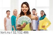 Купить «asian woman with money showing thumbs up», фото № 32132486, снято 11 мая 2019 г. (c) Syda Productions / Фотобанк Лори