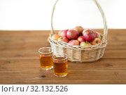 Купить «apples in basket and glasses of juice on table», фото № 32132526, снято 24 августа 2018 г. (c) Syda Productions / Фотобанк Лори
