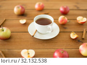 Купить «cup of tea with apples and cinnamon on table», фото № 32132538, снято 24 августа 2018 г. (c) Syda Productions / Фотобанк Лори