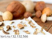 Купить «dried mushrooms on baking paper», фото № 32132566, снято 13 сентября 2018 г. (c) Syda Productions / Фотобанк Лори