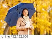Купить «happy woman with umbrella in autumn park», фото № 32132606, снято 13 октября 2018 г. (c) Syda Productions / Фотобанк Лори