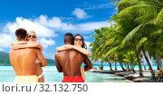 Купить «happy friends or couples hugging on summer beach», фото № 32132750, снято 29 июля 2018 г. (c) Syda Productions / Фотобанк Лори