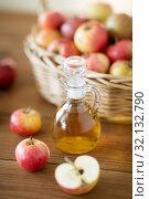Купить «apples in basket and jug of vinegar on table», фото № 32132790, снято 24 августа 2018 г. (c) Syda Productions / Фотобанк Лори