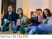 Купить «friends with beer and popcorn watching tv at home», фото № 32132918, снято 22 декабря 2018 г. (c) Syda Productions / Фотобанк Лори