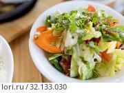 Купить «vegetable salad in bowl at indian restaurant», фото № 32133030, снято 2 мая 2017 г. (c) Syda Productions / Фотобанк Лори