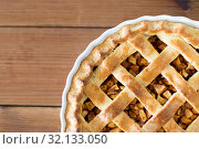 Купить «close up of apple pie in mold on wooden table», фото № 32133050, снято 23 августа 2018 г. (c) Syda Productions / Фотобанк Лори