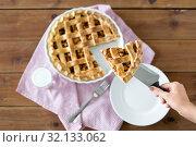 Купить «close up of hand with piece of apple pie on knife», фото № 32133062, снято 23 августа 2018 г. (c) Syda Productions / Фотобанк Лори