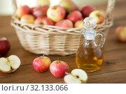 Купить «apples in basket and jug of vinegar on table», фото № 32133066, снято 24 августа 2018 г. (c) Syda Productions / Фотобанк Лори