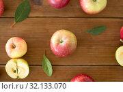 Купить «ripe red apples on wooden table», фото № 32133070, снято 24 августа 2018 г. (c) Syda Productions / Фотобанк Лори