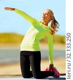 Купить «woman stretching on exercise mat on beach», фото № 32133250, снято 19 июня 2013 г. (c) Syda Productions / Фотобанк Лори