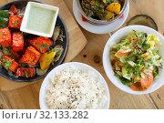 Купить «various food on table of indian restaurant», фото № 32133282, снято 2 мая 2017 г. (c) Syda Productions / Фотобанк Лори