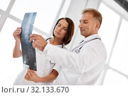 Купить «doctors with x-ray of spine at hospital», фото № 32133670, снято 6 июля 2013 г. (c) Syda Productions / Фотобанк Лори