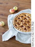 Купить «apple pie in baking mold on wooden table», фото № 32133762, снято 23 августа 2018 г. (c) Syda Productions / Фотобанк Лори