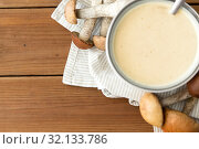 Купить «mushroom cream soup in bowl on cutting board», фото № 32133786, снято 13 сентября 2018 г. (c) Syda Productions / Фотобанк Лори