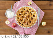Купить «apple pie with ice cream on wooden table», фото № 32133950, снято 23 августа 2018 г. (c) Syda Productions / Фотобанк Лори