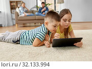 brother and sister with tablet computer at home. Стоковое фото, фотограф Syda Productions / Фотобанк Лори