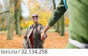 Купить «happy couple with backpacks hiking outdoors», фото № 32134258, снято 27 мая 2016 г. (c) Syda Productions / Фотобанк Лори