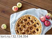 Купить «apple pie in baking mold on wooden table», фото № 32134354, снято 23 августа 2018 г. (c) Syda Productions / Фотобанк Лори