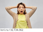 Купить «shocked asian woman holding to her head», фото № 32134362, снято 11 мая 2019 г. (c) Syda Productions / Фотобанк Лори