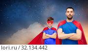 Купить «father and son in superhero capes over night sky», фото № 32134442, снято 3 декабря 2016 г. (c) Syda Productions / Фотобанк Лори