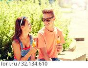 Купить «happy teenage couple eating hot dogs in city», фото № 32134610, снято 19 июля 2016 г. (c) Syda Productions / Фотобанк Лори