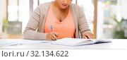 Купить «african american female student with notebook», фото № 32134622, снято 1 августа 2013 г. (c) Syda Productions / Фотобанк Лори