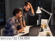 Купить «creative team with computer working late at office», фото № 32134850, снято 24 января 2018 г. (c) Syda Productions / Фотобанк Лори