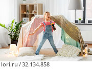 Купить «little girl with toy microphone singing at home», фото № 32134858, снято 18 февраля 2018 г. (c) Syda Productions / Фотобанк Лори