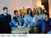 Купить «happy friends watching tv at home in evening», фото № 32134882, снято 22 декабря 2018 г. (c) Syda Productions / Фотобанк Лори