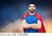 Купить «man in red superhero cape over night sky», фото № 32135066, снято 3 декабря 2016 г. (c) Syda Productions / Фотобанк Лори