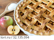 Купить «close up of apple pie on wooden table», фото № 32135094, снято 23 августа 2018 г. (c) Syda Productions / Фотобанк Лори