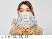 Купить «asian woman with hundreds of dollar money», фото № 32135134, снято 11 мая 2019 г. (c) Syda Productions / Фотобанк Лори
