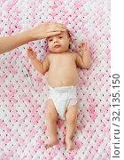 Купить «mother's hand measuring temperature of baby girl», фото № 32135150, снято 23 мая 2019 г. (c) Syda Productions / Фотобанк Лори