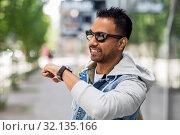 Купить «indian man recording voice message by smart watch», фото № 32135166, снято 22 июня 2019 г. (c) Syda Productions / Фотобанк Лори
