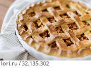Купить «close up of apple pie in baking mold», фото № 32135302, снято 23 августа 2018 г. (c) Syda Productions / Фотобанк Лори