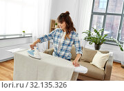 Купить «asian woman or housewife ironing bed linen at home», фото № 32135326, снято 13 апреля 2019 г. (c) Syda Productions / Фотобанк Лори