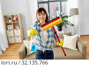 Купить «asian woman with window cleaner and sponge mop», фото № 32135766, снято 13 апреля 2019 г. (c) Syda Productions / Фотобанк Лори