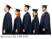 Купить «graduates in mortar boards and bachelor gowns», фото № 32135910, снято 10 ноября 2018 г. (c) Syda Productions / Фотобанк Лори