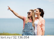 Купить «teenage girls or best friends at seaside in summer», фото № 32136054, снято 20 июня 2019 г. (c) Syda Productions / Фотобанк Лори