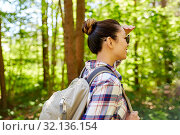 Купить «happy asian woman with backpack hiking in forest», фото № 32136154, снято 15 июня 2019 г. (c) Syda Productions / Фотобанк Лори