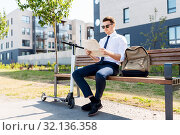 Купить «businessman with scooter reading newspaper in city», фото № 32136358, снято 1 августа 2019 г. (c) Syda Productions / Фотобанк Лори