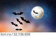 Купить «black bats flying over moon in starry night sky», фото № 32136658, снято 6 июля 2017 г. (c) Syda Productions / Фотобанк Лори