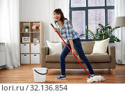 Купить «happy asian woman with mop cleaning floor at home», фото № 32136854, снято 13 апреля 2019 г. (c) Syda Productions / Фотобанк Лори