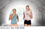 Купить «women or female friends with earphones running», фото № 32136954, снято 28 июля 2019 г. (c) Syda Productions / Фотобанк Лори